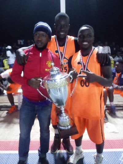 Michael Ikima of Benue Braves (right) with the 2017 Mark d'Ball basketball trophy