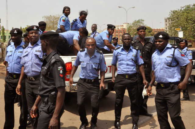 Nigerian policemen working to curb crime