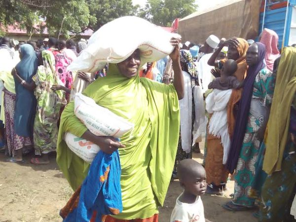 An IDP happy to have collected her food item