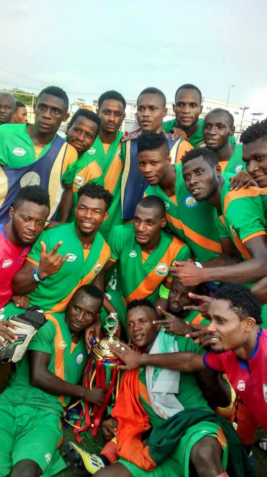 Players of Go Round FC celebrate with their trophy