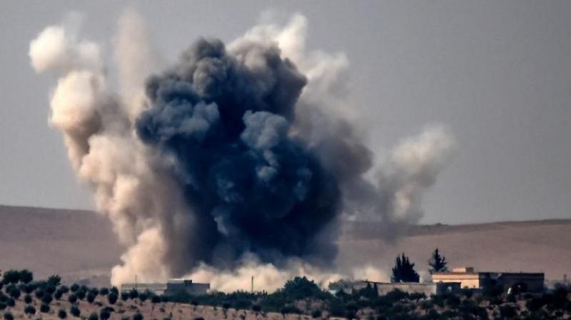 Smoke from the Turkish warplanes bombardment