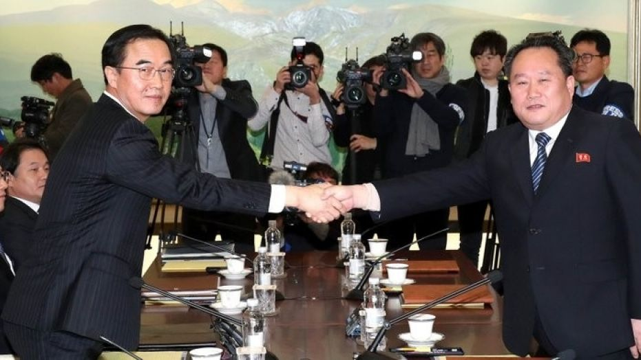 South Korean Unification Minister Cho Myoung-gyon, left, shakes hands with the head of North Korean delegation Ri Son Gwon